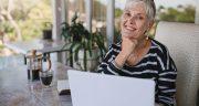 Beautiful Senior Woman Using Laptop At Home. Mature Smiling Woma